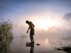 Picture of a man standing in a lake in India