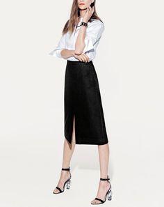 J.Crew women's piqué bib shirt, midi skirt, postmodern bracelet, and Sophia Webster Nicole heels.