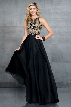Karishma Creations prom dress. This dress features a black chiffon skirt and gold embroidery that covers the top of the dress. #KarishmaCreations