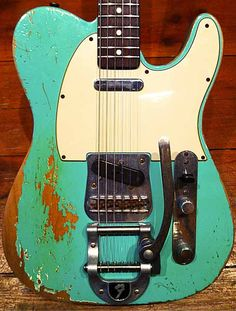 Fender Custom Shop 60 telecaster heavy relic surf green. thanks to my brother for buying it for me. This is a great guitar and the BIgsby only makes it better.