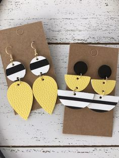 Handmade Black, yellow and white leather earrings. These are perfect for football season to support your favorite team! All earrings are made with stainless steel, hypoallergenic hooks. Diy Leather Earrings, Funky Earrings, Diy Earrings, Leather Jewelry, Handmade Accessories, Handmade Jewelry, Handmade Items, Handmade Gifts, Baubles And Beads