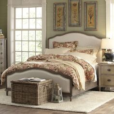 Refresh your master suite with this lovely bed, featuring a gracefully arched design and neutral upholstery.Product: Bed...