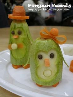 Fruit Carving Arrangements and Food Garnishes: Penguin Family. Fruit and Vegetable Carving Demo at Christmas Crafts Exhibition.
