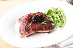 Heart healthy salmon topped with a bold blackberry sauce is delicious and loaded with antioxidants and omega-3s! via livelytable.com