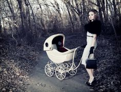 Vintage Woman with Stroller from Getty.