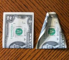 Fold the bills in half first as it will make curling the edges easier.