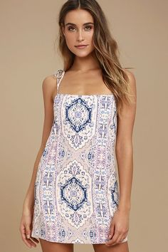 Lulus Exclusive! Show off your casual-cool style in the That's What I Like Blush Pink Print Shift Dress! Lightweight woven rayon in a light blue, navy blue, pink, and beige print falls from tying straps into a breezy shift silhouette.