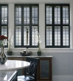 dark wood plantation shutters with a blue colored wall white molding - March 24 2019 at Interior Wood Shutters, White Shutters, Interior Windows, Wooden Shutters Indoor, Indoor Shutters For Windows, White Doors, Bedroom Walls, Bedroom Doors, Black Blinds