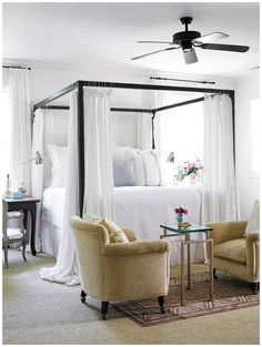 Romantic four poster bed with voiles