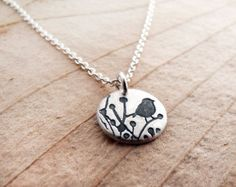 Please note that orders placed between 31 October and 4 November will ship on Monday 7 November. Heres a cute little chickadee necklace!  - The pendant is very small indeed, a bit under 1/2 in diameter, or 11mm. It has a matte finish.  - Entirely hand made by me! I start with my original drawing, make my own stamping tool and then create the piece. - The pendant is .999 pure silver, much of it recycled. The chain and jump ring are .925 sterling silver (sterling is a mix of silver and…