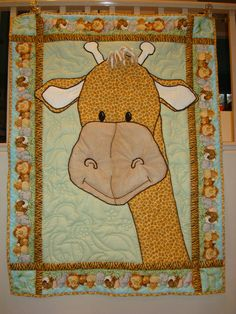 Custom giraffe baby quilt using Patty Reed Design prints - enlarging a character and rearranging the fabric a little. www.quiltasdesired.com