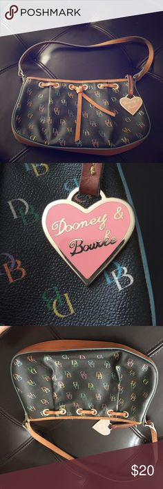Dooney & Burke small purse Cute small Dooney & Burke purse. Great size for going out. Has brown accents and colorful DB letter. Goes great with everything. Dooney & Bourke Bags Shoulder Bags