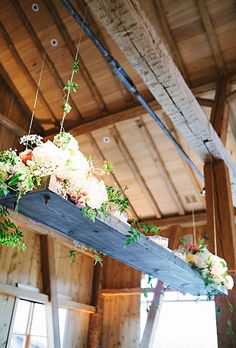 Rustic Plank Chandelier with Fresh Flowers. The Perfect Petal turned long, rustic beams into beautiful floral chandeliers by adding plenty of lush blooms to the ends. Chandelier Wedding Decor, Flower Chandelier, Wedding Decorations, Wedding Ceiling, Aisle Decorations, Wedding Centerpieces, Lustre Floral, Wedding Reception, Rustic Wedding