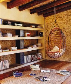 Digging this hanging chair and those book cases