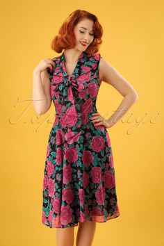 This 50s Eden Rose Dress in Blackis one to fall in love with!We can't  get enough of roses. This stunner is full of them, so you'll  understand why she's making us totally happy ;-) Besides the amazing print, she  features lovely tie straps at the neckline and playful ruffles. She runs from the waist down into a flowy semi-swing skirt,  creating a super feminine silhouette. Made from a breezy, supple, black  semi-sheer fabric (doesn't stretch!) and the slip dress ensures a lovely  fit. Whe