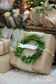 Packaging gift with burlap and mini wreaths. Such a great idea for unique Christmas wrapping.