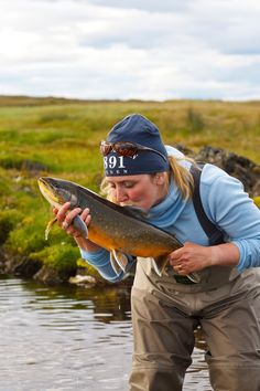 The kiss - My lovely wife with the fish of a lifetime taken on the dryfly in a rivermouth in iceland. Perfect cover shot material for a flyfishing magazine. Any takers?