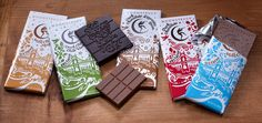 Hand-cut paper illustration, foil stamping, etc.  Moonstruck Chocolate by Sandstrom Partners