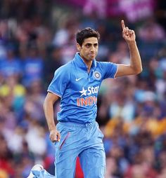 Ashish Nehra (above) struck early, dismissing the in-form Usman Khawaja