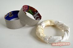 Step One Bangles – Cut narrow strips of card from the cereal box, curve it around in your fingers and by slipping it on and off over your child's knuckles decide on the diameter of the bracelet. Staple or cellotape the ends together to this diameter. Remember the bracelet shape will bulk up with the papier mache layer to allow for some give. Fold some newspaper on it's length to create a thicker band to run over the cardboard and cellotape to the cardboard at intervals all around the curve.
