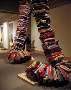 Marie Watt, Blanket Stories: Objects, stacked and folded wool blankets, and salvaged cedar, 2004-05.