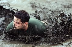 Marines and sailors get a little muddy during the 20th annual World Famous Mud Run as a part of the Commanding General's Cup at Marine Corps Base Camp Pendleton, Calif., June 7. The service members entered in teams of five or individually and trudged through 6.2 miles of dirt, mud and off-road obstacles.