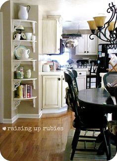 Raising up Rubies: a shabby vintage kitchen . ♥ In place of a corner cabinet! This will work so perfect in our new dining room! Then I want a corner cabinet in the other corner Dining Room Corner, Kitchen Corner, New Kitchen, Vintage Kitchen, Kitchen Decor, Kitchen Ideas, Bathroom Vintage, Corner Stove, Corner Shelves