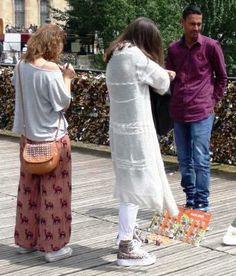 "Writing on, buying, selling ""love locks"" on Pont Des Artes"