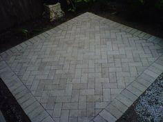 herringbone pattern for patio pavers. I like this idea for shower floor tiles