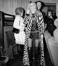 Brigitte Bardot- floor-length zebra print coat, thigh-high boots, and chain-link belt Brigitte Bardot, Bridget Bardot, Vanessa Redgrave, Isabella Rossellini, Tilda Swinton, Catherine Deneuve, Helen Mirren, Marlene Dietrich, 70s Fashion