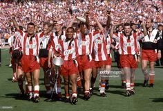 Winning goalscorer Mark Stein carries the trophy as the Stoke City. Stoke City Fc, Wembley Stadium, Stoke On Trent, Newcastle, Premier League, Carry On, Football, Club, London