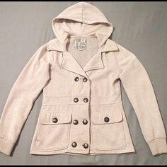 Billabong Jacket Hoodie Billabong Jacket with Hood. Button front, has hood and collar, side slit pockets, warm lining, soft cream color. Back is ribbed for some stretch, keeps front in shape. Super cute, great for Fall. Billabong Jackets & Coats