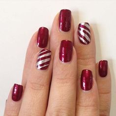 29 festive christmas nail art ideas: red nails with candy cane stripe accent nail; Holiday Nail Art, Christmas Nail Art Designs, Winter Nail Art, Winter Nails, Christmas Design, Xmas Nails, Red Nails, Easy Christmas Nails, Fabulous Nails