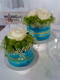 Tischdekoration Törtchen mit Blumen Messe