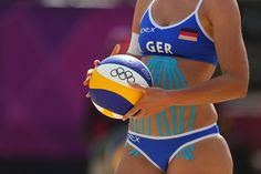 Olympics Day 1 - Beach Volleyball. Katrin Holtwick of Germany wearing a large SpiderTech Lymphatic