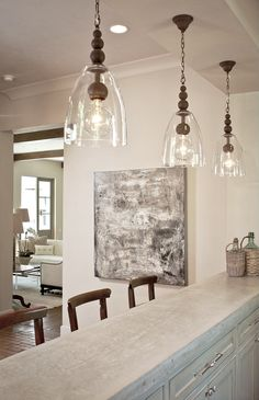 I really like these pendants. via Cote de Texas