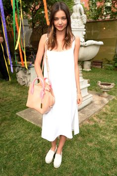 50 ways to wear a little white dress this summer: Miranda Kerr pairs her white tank dress with sneakers