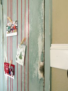 {Wrap yarn around a door, then clothes pin Christmas cards onto it.} Great idea! Thin ribbon or cording would work, too!  I have used thick red ribbon with thumb tacks and the tiny coloured pegs you can buy from the cheap stores.  Gorgeous.