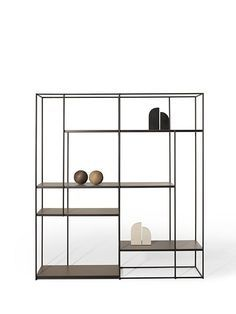 Utmost simplicity and a stunning silhouette characterize the Hill bookcase, whose airy metal shelves seem almost to float in mid-air. Furniture, Shelves, Interior, Bookshelves, Home Furniture, Steel Furniture, Interior Furniture, Furniture Bookshelves, Shelving
