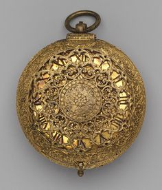 Clock watch, ca. 1600-1610  Movement by Michael Nouwen, or Nouen (Flemish, active London, ca. 1600–1610)  Case: gilded brass; Dial: gilded brass, with a blued steel hand; Movement: gilded brass and iron