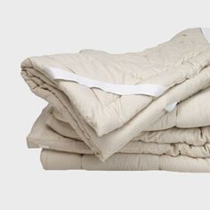 """Sleep and Beyond 2"""" thick wool mattress pad- to make super-firm Ikea latex mattress cozy!  Only $142 at Wildflower Organics with holiday shopping card."""