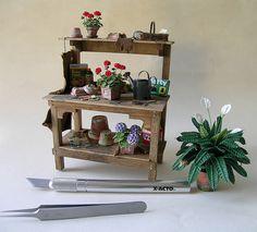 potting bench ideas | potting bench vignette and potted spathiphyllum ooak potting bench ... Potting Tables, Red Geraniums, Peace Lily, Blue Hydrangea, Vignettes, Bench, Woodworking, Miniatures, Plants