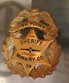 2010 & 2009 Buford Pusser Home & Museum Adamsville Tennessee McNairy County Walking Tall Sheriff   Sheriff Buford Pusser badge in showcase at museum by wrbphotography, via Flickr