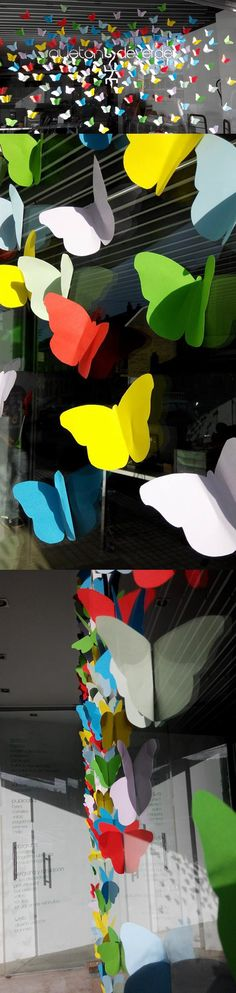 Cut butterfly shapes out of pretty papef and use throughout display