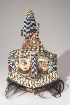 Kete, Lulua, Congo, cloth, wood, cowrie shells, leopard hide,feathers, thread, pigment,metal, hair, early 20th cent.