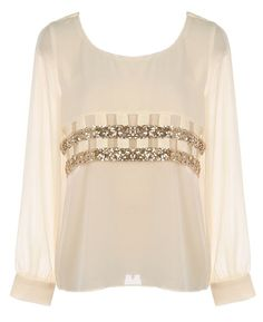 Glitter Bands Blouse: Features a chic bateau neck with keyhole design at nape, semi-sheer bracelet length sleeves finishes with crisp cuffs and gold-button closure, laser-cut lattice work to the front crowned with glittering gold sequin trim, and a solid ivory backside to finish.