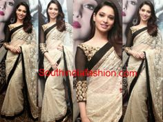 Actress Tamanna in off white lace saree with black border paired up with gold zari work black blouse with three quarter sleeves at Joh Rivaj event in Chennai.