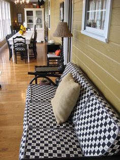 """""""closed in porch becomes a long and narrow sunroom"""" -- THE ACTUAL CAPTION. This is exactly what happened with ours. I like the idea of the long table."""