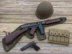 Thompson M1A1 submachine gun and Colt M1911.