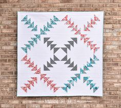 Do you remember at the end of Augustwhen I showed you five fat quarters that I was going to use in a new quilt design? Well, I'm finished!! I've named this quilt Criss Cross and am b…